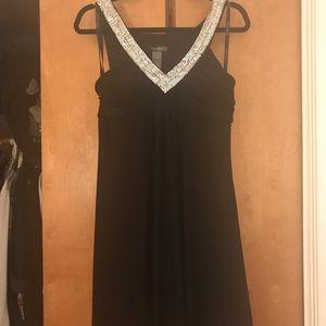 Black dress with sparkly silver neckline